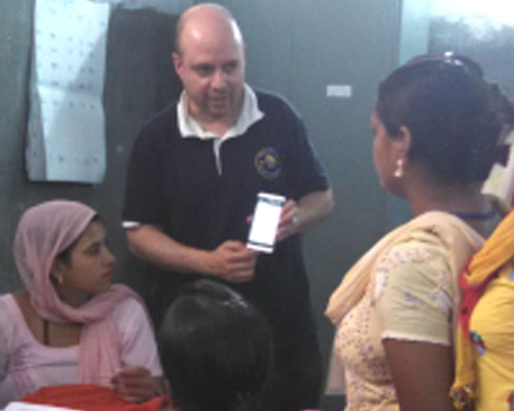 Rich Fletcher of the Mobile Technology Group explaining a phone app to health workers.