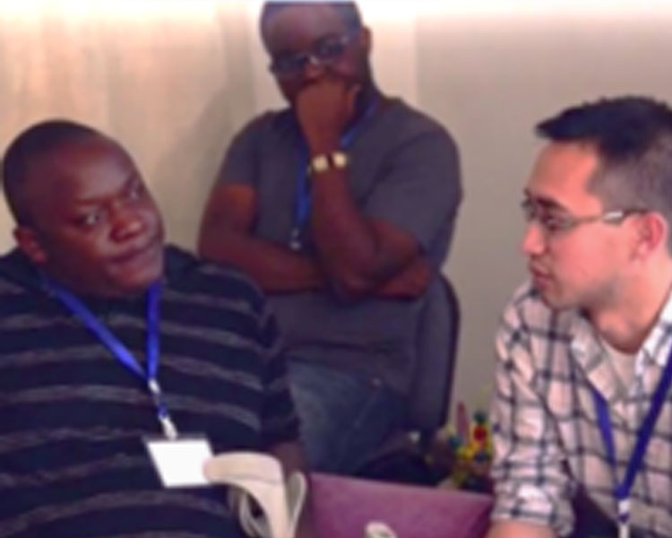 Bryan Ranger talking with Fred Ouko, Director of Action Network for the Disabled, in Nairobi, Kenya.