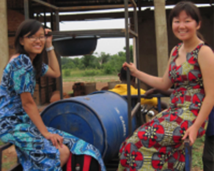"""Hope in Flight"" students Yiping Xing and Coyin Oh with their Black Soldier Fly composter in Tamale, Ghana"
