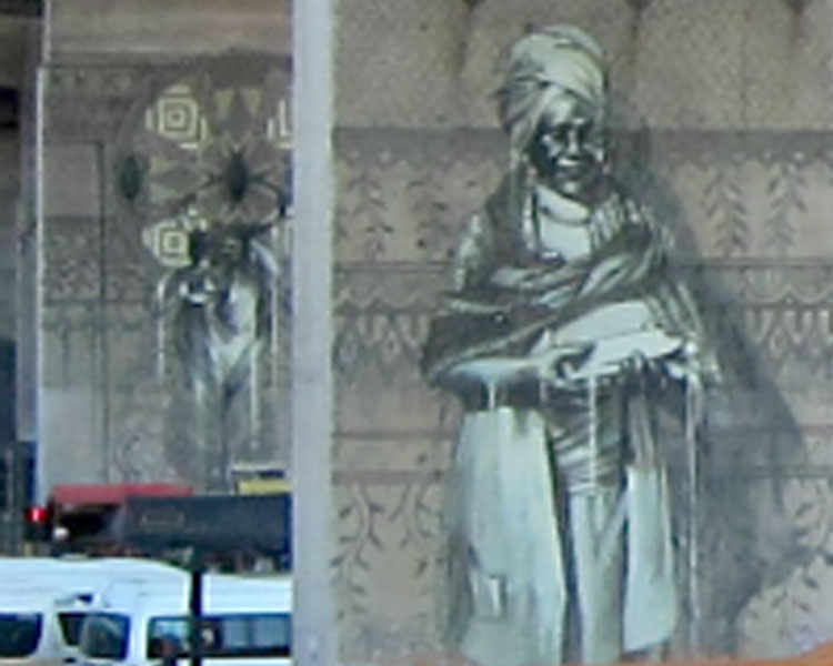 Murals memorializing local traders near the Early Morning Market.