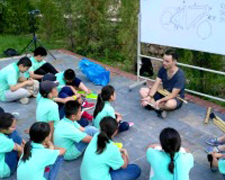 Teaching bike mechanics to middle school students in the countryside outside of Beijing.