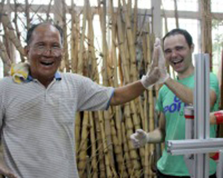 Teaching Teacher Liu to make his own bamboo bicycle. The Bamboo Culture Park plans to make 30 bamboo bikes for visitors to bike around the village and surrounding area.