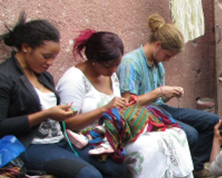 Crocheting with community members. Trip co-leader Nani Ruiz at right.