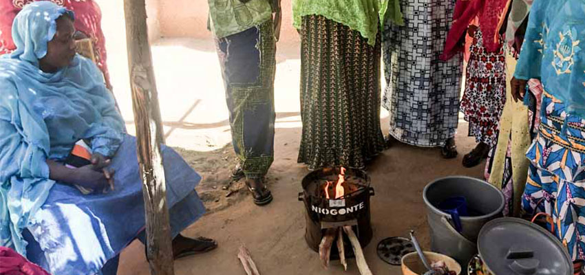 Watching an efficient cookstove demonstration in Ansongo, Mali.