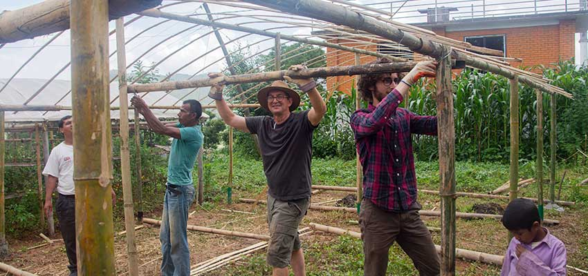 Members of the team working on the roof of the greenhouse. Left to right: Krishna Adhikari, Sanubai, Bob Nanes, Matthew Baldwin, Sanubai's son.