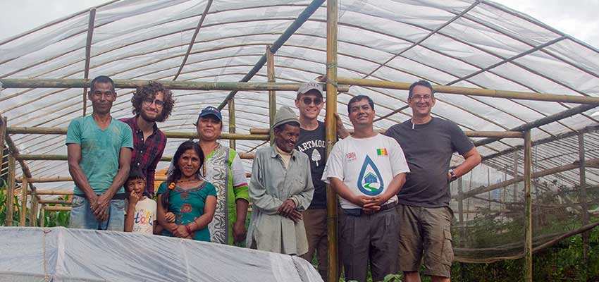 The team in front of the finished greenhouse. From left to right: back row: Matthew Baldwin, Rita Rai Shrestha, Robert Powell, Bob Nanes; front row: Sanubai, Sanubai's son, Sanubai's Wife, Sanubai's Father, Krishna Adhikari.