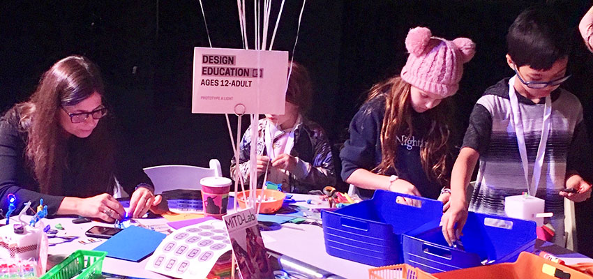 D-Lab Program Associate Melissa Mangino (right) helps visitors young and old prototype fanciful battery-powered LED lights at the Cooper Hewitt National Design Week Design Fest.