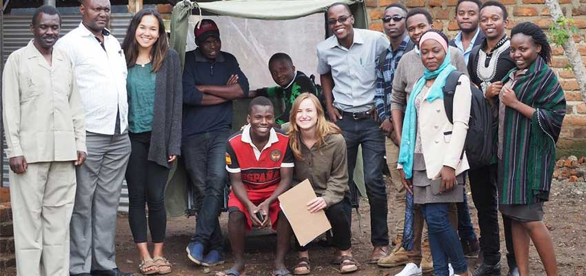 Emily Young '18 (third from left) and Eva Boal '18 (front right) of the Okoa Project with interns from Mbeya University of Science and Technology.